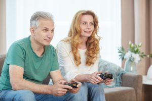 Mature Couple Playing Videogame